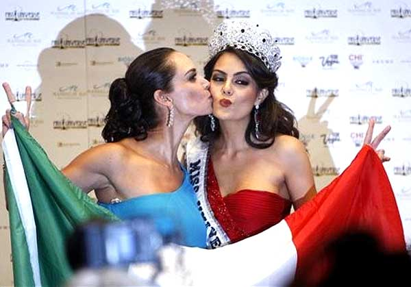 Two Mexican Miss Universes: Lupita Jones, Miss Universe 1991 and national director for Mexico kisses the new Miss Universe 2010, Ximena Navarrete