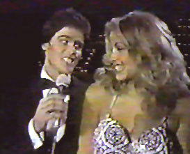 Donny Osmond serenades Miss USA 1980, Jineane Ford of Arizona during the 1980 Miss USA pageant